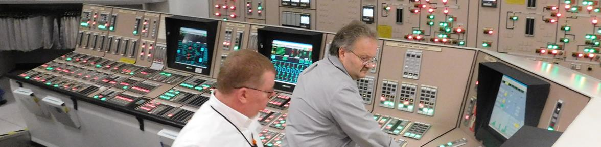 PSEG Power operators managing a control panel.