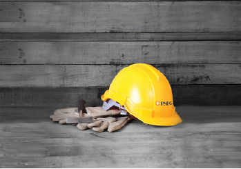 A hard hat and gloves on a job site