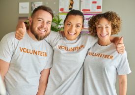Three volunteers with their arms around each other
